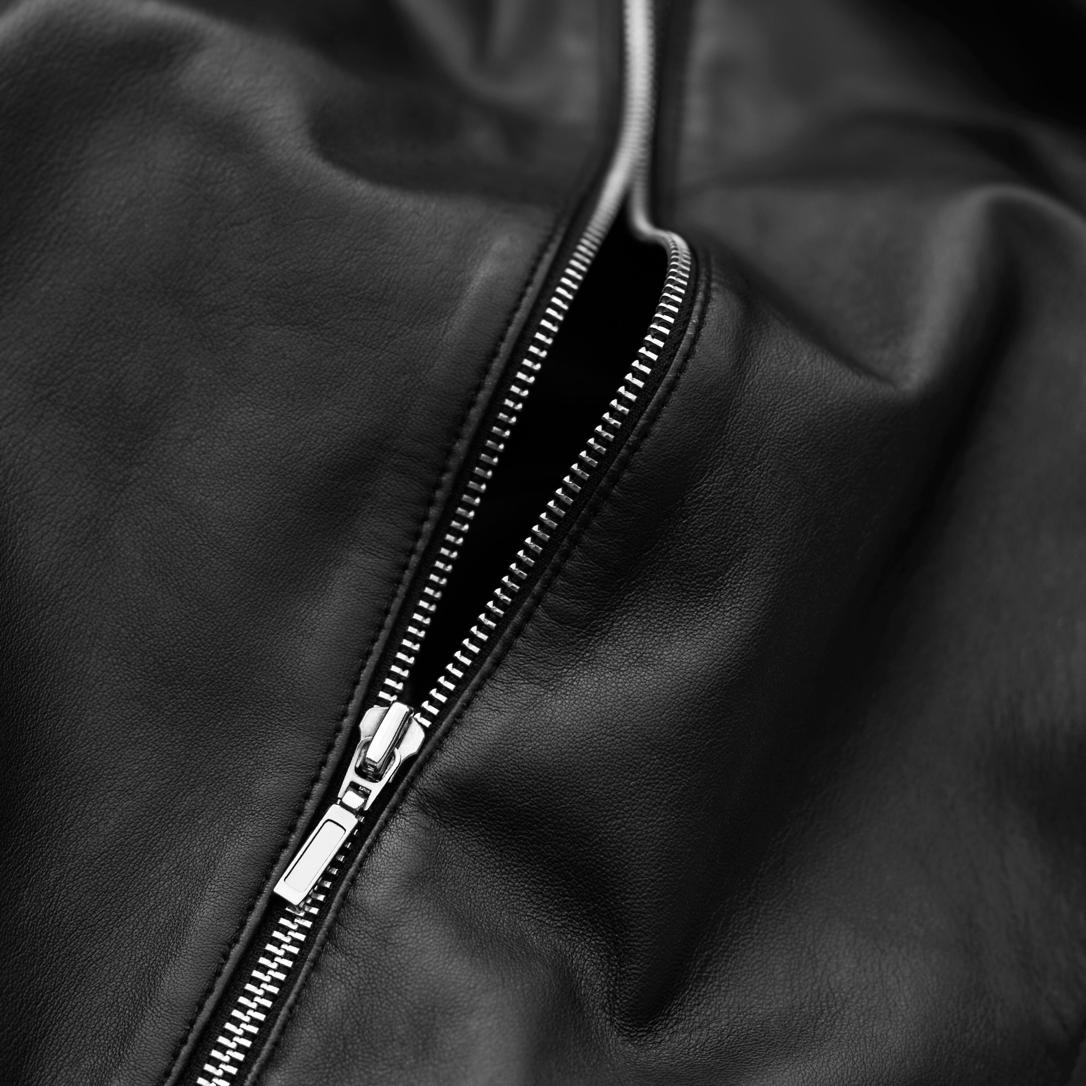 A zip in a black jacket.