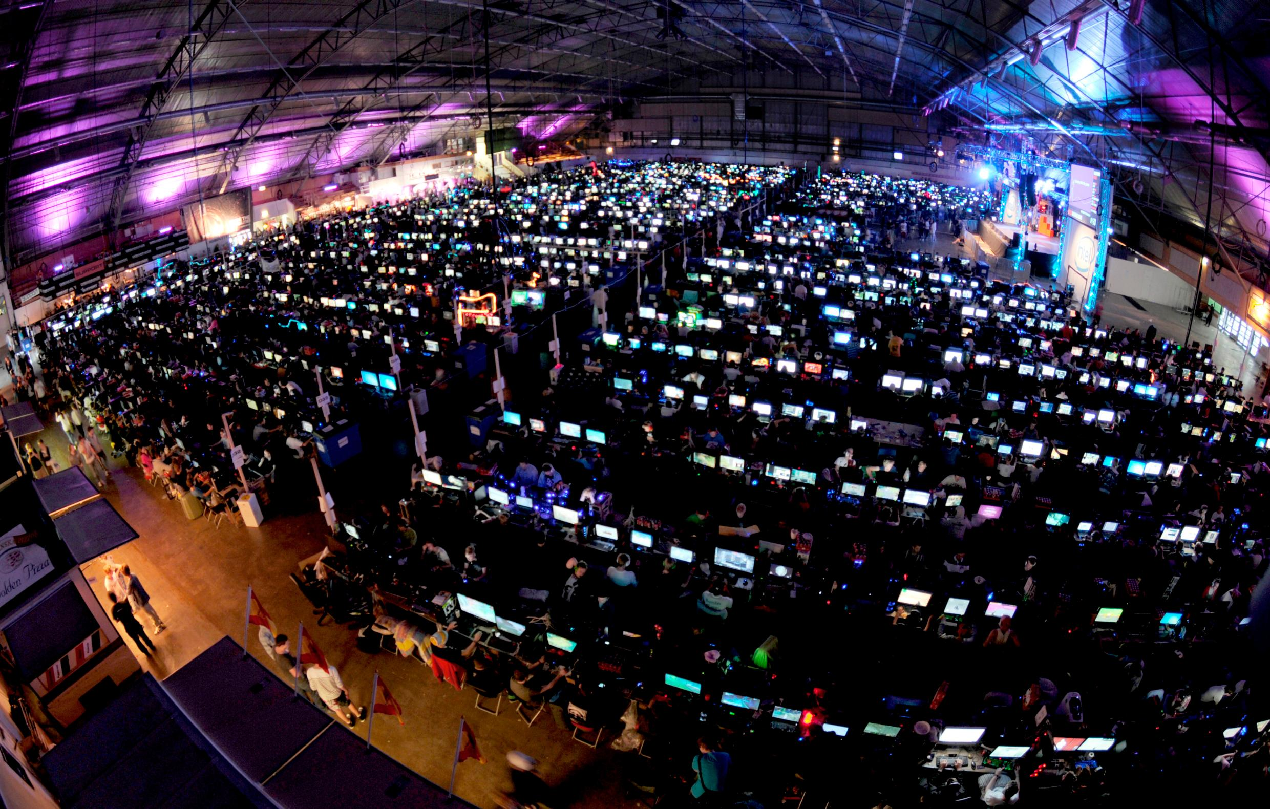 A huge arena filled with lit up computer screens.