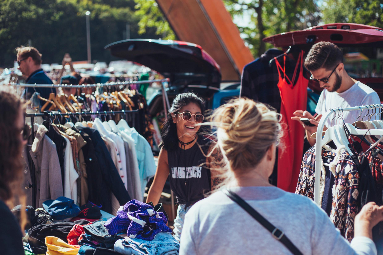 Shoppers at an outdoors flea market.